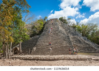 Coba, Yucatan, Mexico, Central America, March 2017 – tourists climbing the pyramid at Coba, the ruins of the ancient Mayan city.