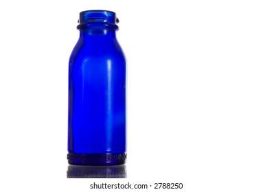Cobalt blue colored medicine bottle - antique on white background