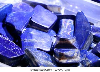 Cobalt blue lapis lazuli stones. Selected focus. Minerals exhibition