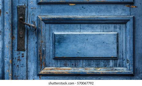 21a921ec08b Cobalt blue painted aged worn wooden door with black wrought iron latch