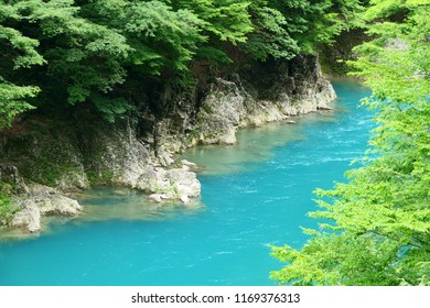Cobalt blue water.This place is Dakigaeri Gorge.A points of interest in Tazawa Senboku Akita Japan.The middle of July.