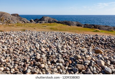 Cobble deposit from the recent ice age or beach of rolling stones at Molen, first UNESCO Global Geopark in the Nordic Countries near Larvik, Vestfold County, Norway