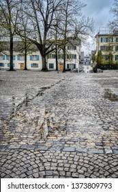 Cobble stone paving on Lindenhof Square, Zurich, Switzerland, after rain