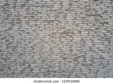 Cobble Stone Street with Pale White Stones and Gray/Grey Mortar.