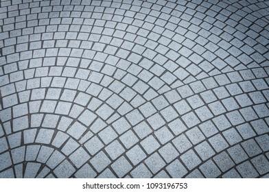 Cobble stoned pavement.