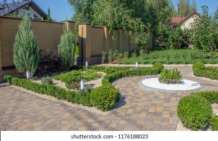 Cobbled concrete paving slab track in a beautifully manicured garden
