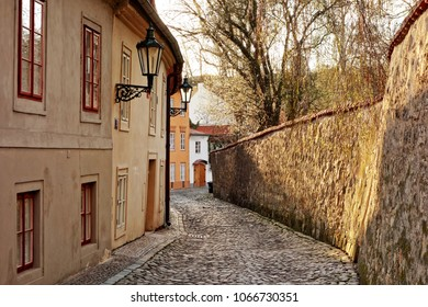 Cobbled narrow street and small ancient houses of Novy Svet, Hradcany district, Prague, Czech Republic