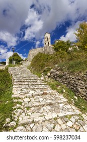 A cobbled path in the village of Kalarrytes, in Tzoumerka region, Ioannina prefecture, Epirus, Greece. The village and the region are famous for the local stonemasons who worked all across Greece.