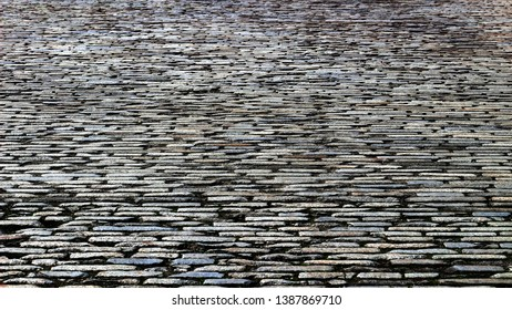 Cobbled road close up background stock photos
