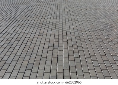 Cobbled stone road shown at a low angle.