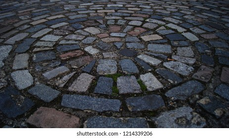 Cobbled street spot layed in circural pattern.