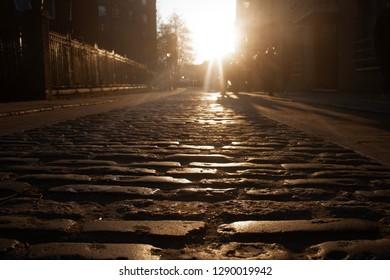 Cobbled street at sunset