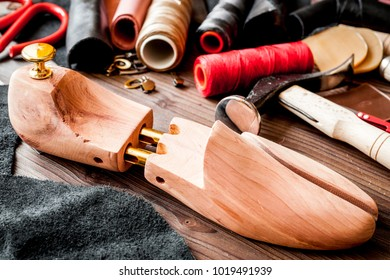 cobbler tools in workshop on wooden background mock up