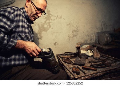 cobbler at work with old tools