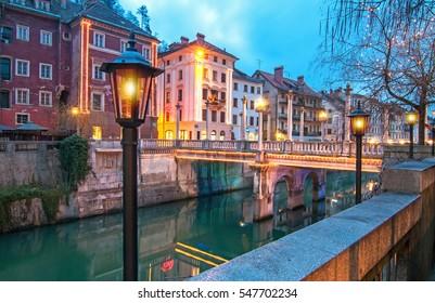 Cobblers bridge, illuminated for Christmas and New Year's celebration, Ljubljana, Slovenia