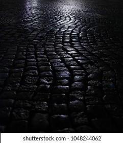 Cobbles or paving stone at night. Stock image.