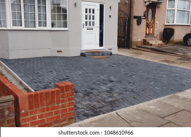 Cobblestone driveway, residential area, London, England.