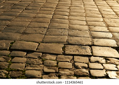 cobblestone floor with light flush at sunset