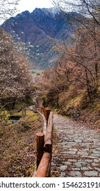 Cobblestone footpath in ancient Bard town in Aosta valley, Piemonte, Italy. In the vicinity of iconic snow capped mountains as Matterhorn, Mont Blanc, Monte Rosa, Gran Paradiso and ski resorts.