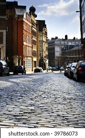 Cobblestone paved street in London on sunny day