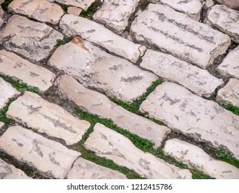 cobblestone pavement, road with cobblestones, background cobblestones