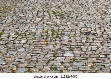 Cobblestone road with grass, background, texture