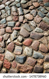 Cobblestone road. Multicolored cobblestone texture.