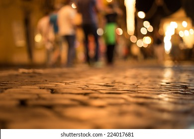 cobblestone road at night in Italy