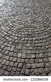 Cobblestone stone pavement background texture on the street