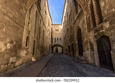 Cobblestone street between high walls in a medieval city
