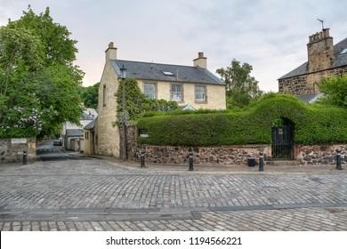 Cobblestone street of Duddingston, close to Holyrood park, Scotland, UK