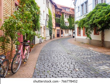 Cobblestone Street with Pink Bicycle in Heidelberg
