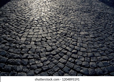 cobblestones, on the pavement in the evening light