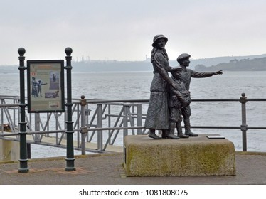 Cobh, Ireland, April 12, 2018 -- The Annie Moore statue stands outside the Cobh Heritage Centre. It commemorates the first immigrant to the United States to pass through the facility at  Ellis Island.