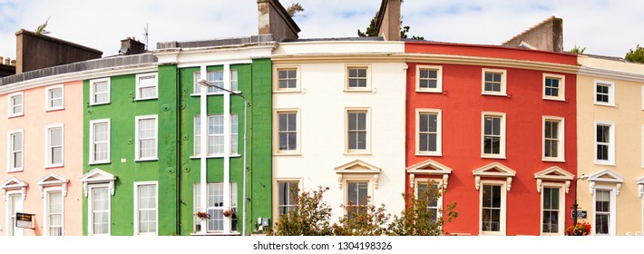 Cobh, Ireland - February 4, 2019: A panoramic view of colorful houses in the town of Cobh near Cork in Ireland.