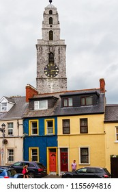 COBH, IRELAND - JULY 13, 2018: Cathedral and colored houses in Cobh, Ireland
