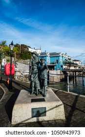 Cobh, Ireland - November 9, 2017: Bronze sculpture in  promenade of Cobh a sunny morning. Cobh is a picturesque irish town near Cork