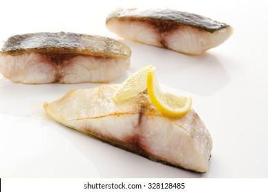 Cobia, fried fish filet with lemon slice