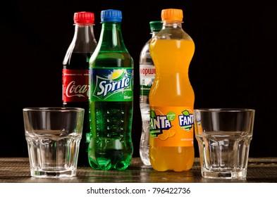 Coca Cola, Fanta, Sprite with glasses on a dark background. Kyiv 02/10/17