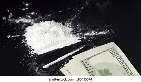 cocaine dose and money on black surface