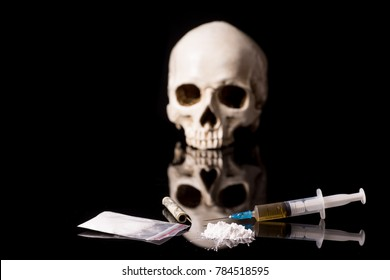 cocaine, Herion or other illegal drugs that are sniffed by means of a tube or injected with a syringe isolated on black glossy background