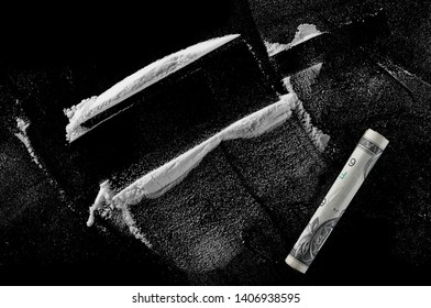 Cocaine lines isolated on black background, clipping path