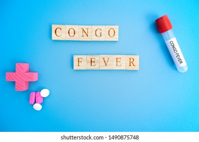 Cocept of Crimean Congo hemorrhagic fever, congo Fever or CCHF in wooden block letters with laboratory tubes.