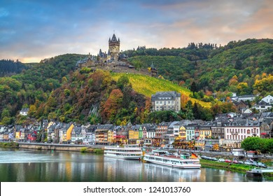 Cochem in autumn, Germany. Cityscape with Moselle river, colorful houses on embankment and Cochem Castle