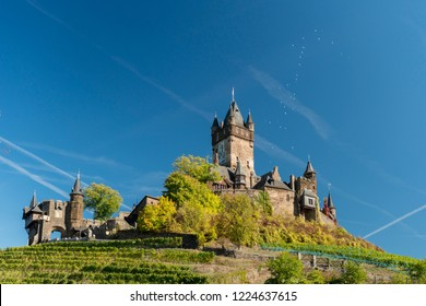 Cochem Castle and vineyards with balloons floating up from the castle, Cochem, Germany