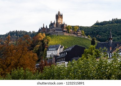 Cochem, Germany – 09-16-2018: Cochem Castle (or Reichsburg) is beautiful on an early autumn evening. This is a popular and romantic tourist destination along the Moselle river in Germany.