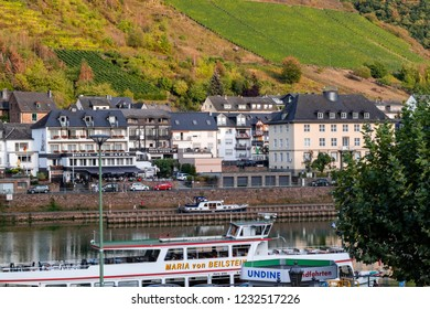 Cochem, Germany – 09-16-2018: Cruise liners, hotels and vineyards in Cochem, Germany. A romantic tourist destination in the Moselle Valley.