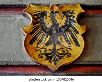 COCHEM, GERMANY - 2014: The Reichsadler (Imperial Eagle) is the heraldic eagle used by the Holy Roman Emperors and modern coats of arms of Germany. Interior of the Cochem Castle (Reichsburg or Burg).