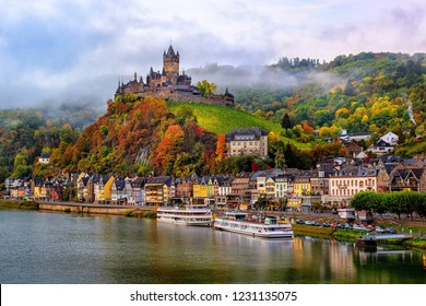 Cochem, Germany, beautiful historical town on romantic Moselle river, city view with Reichsburg castle on a hill in autumn color