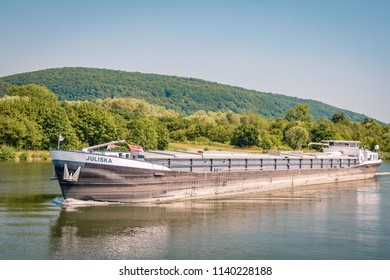 Cochem Germany July 2018, inlandshipping transport over the rover Mosel in germany on a bright summer day in the mountans